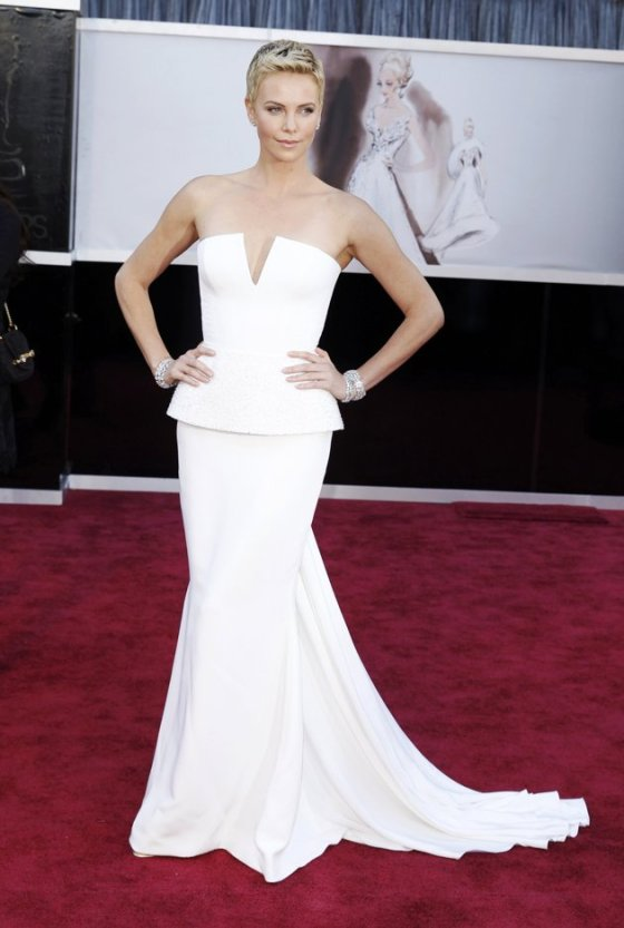 Like always, Charlize Theron rocked the 2013 Oscars red carpet. Gown by Dior.